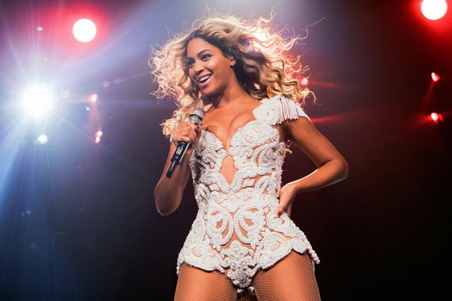 "IMAGE DISTRIBUTED FOR PARKWOOD ENTERTAINMENT - Beyonce performs onstage at her ""Mrs. Carter Show World Tour 2013,"" on Saturday, December 7, 2013 at the US Airways Center in Phoenix, Arizona. (Photo by Robin Harper/Invision for Parkwood Entertainment/AP Images)"
